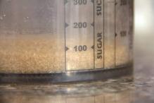 Meet 100 gram suiker af