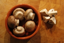 Snij de champignons